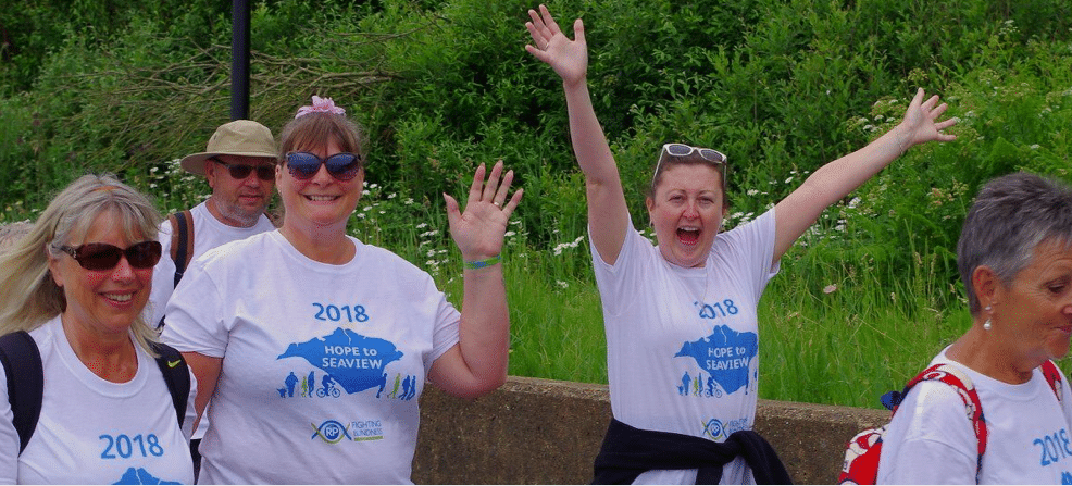 fundraisers in t shirts waving