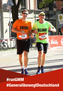 Victor and his guide running the Munich Marathon
