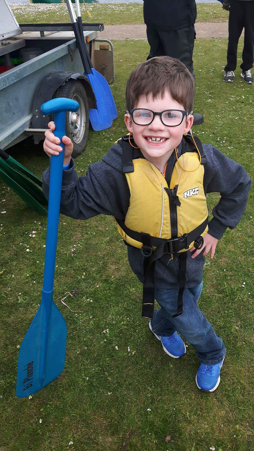 Boy smiling wearing a life jacket