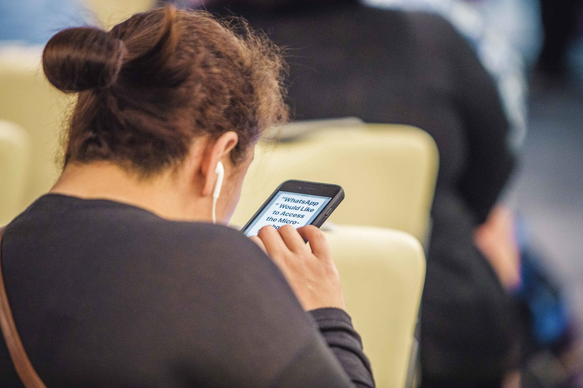 Woman looking at information on mobile phone