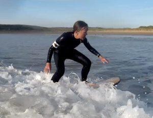 Victoria Claire surfing