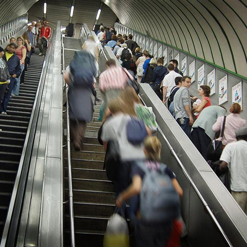 Commuters riding escalators on London Underground