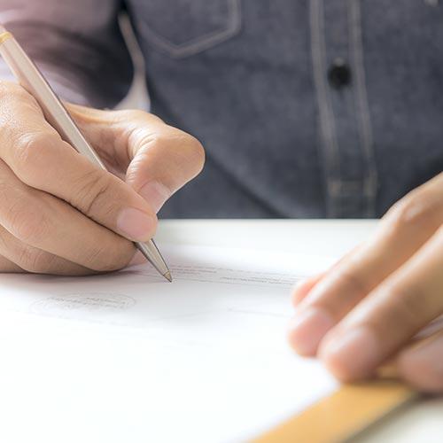 Man signing share paperwork