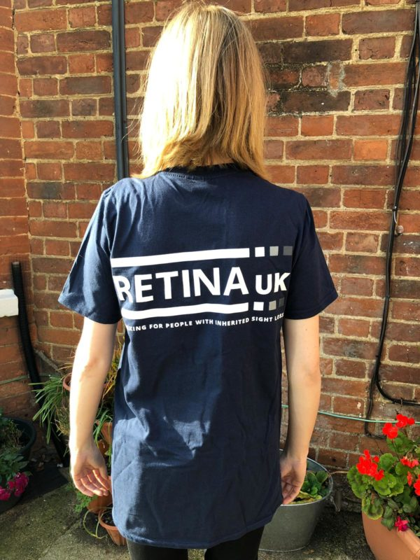 The Retina UK t-shirt shown from t he rear with the Retina UK logo printed in white on a dark blue tshirt.
