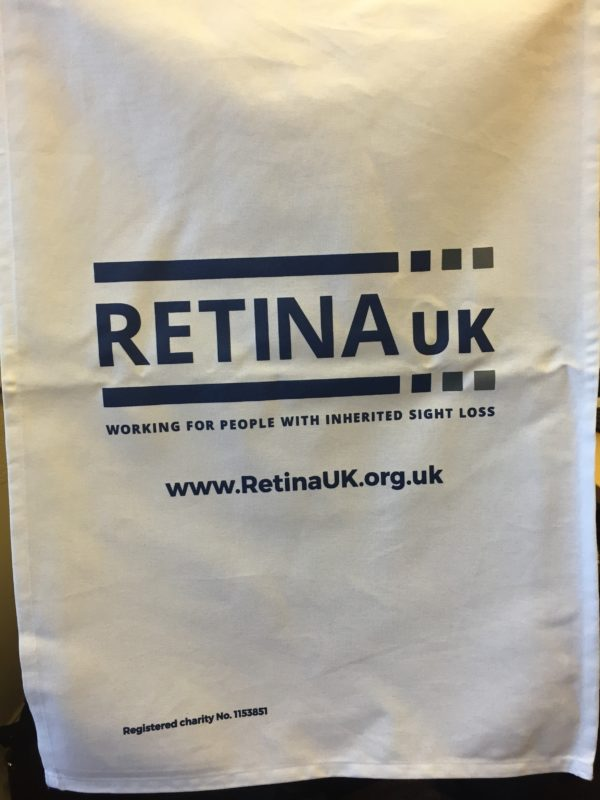 White tea towel with blue Retina UK logo