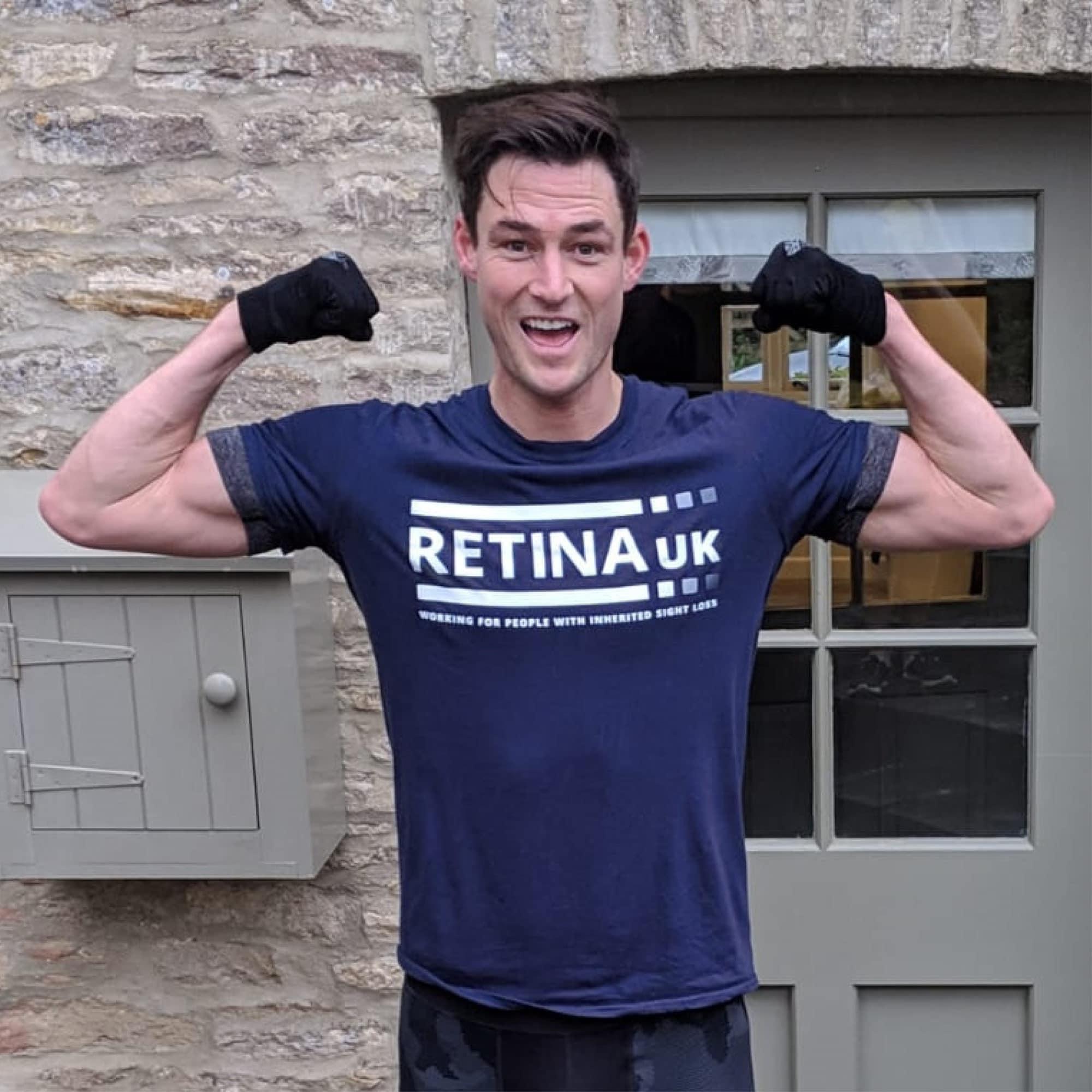 James Farrar wearing a Retina UK tshirt