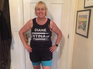 Diane Bentham, wearing her Retina UK running vest