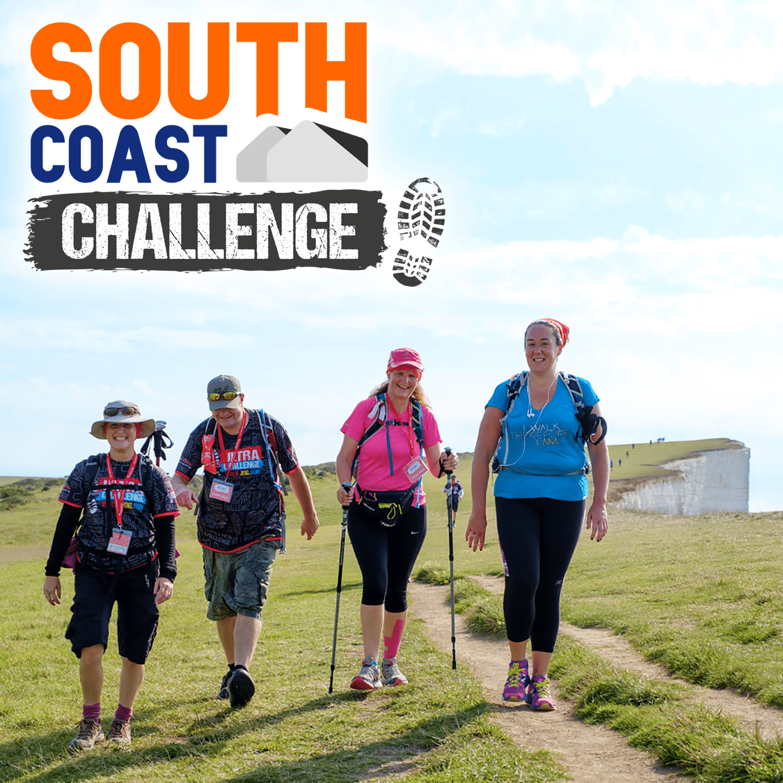 Image shows four walkers walking along a coastal path. White cliffs can be seen in the distance. 'South Coast Challenge' is written on the top left of the image.