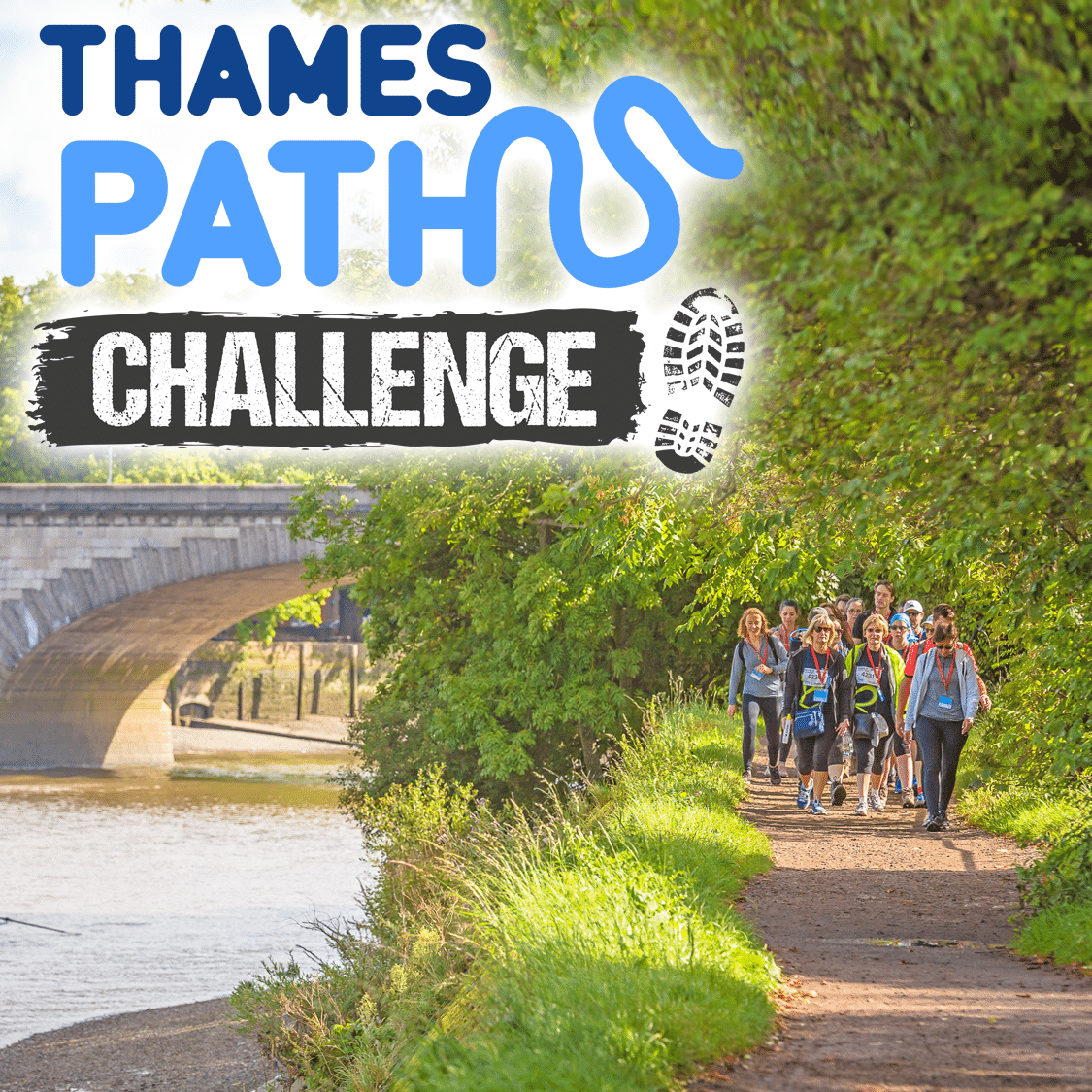 Image shows a group of walkers walking along a path with the Thames to the left and a hedgerow to the right. A bridge can be seen in the background. 'Thames Path Challenge' is written on the top left.