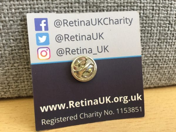 The rear of the Retina UK pin badge showing a butterfly type clip