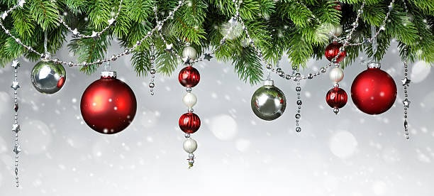 Christmas baubles hanging from the branches of a Christmas tree
