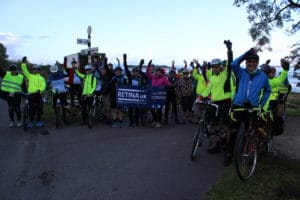 Group shot at the start with arms in the air