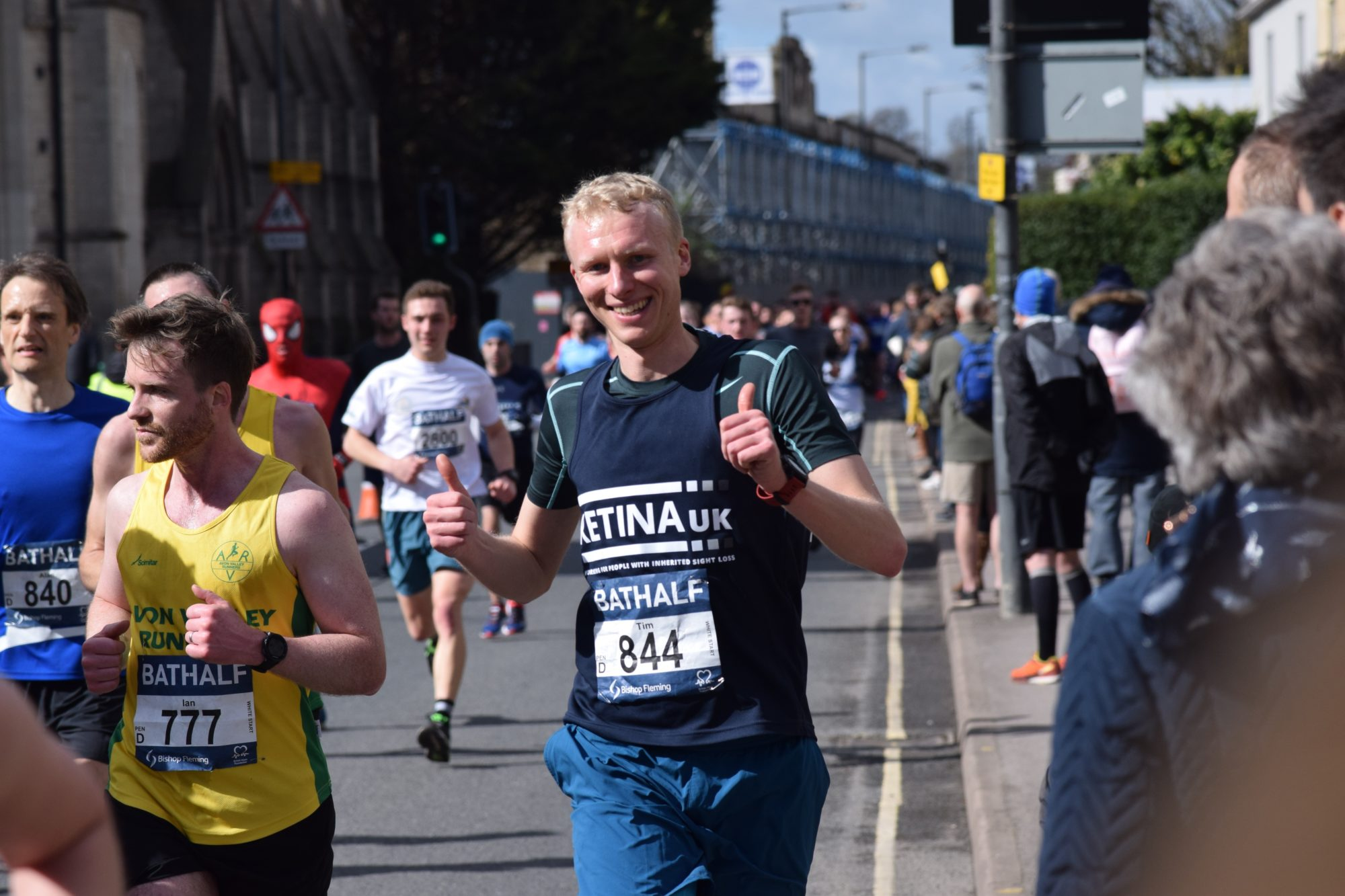 A man in a Retina UK tshirt running amongst other runners