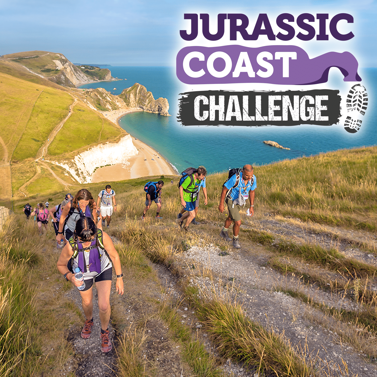 Image shows a group of walkers walking along a coastal path. White cliffs and Durdle Door are visible in the background. 'Jurassic Coast Challenge' is written on the top right of the image.