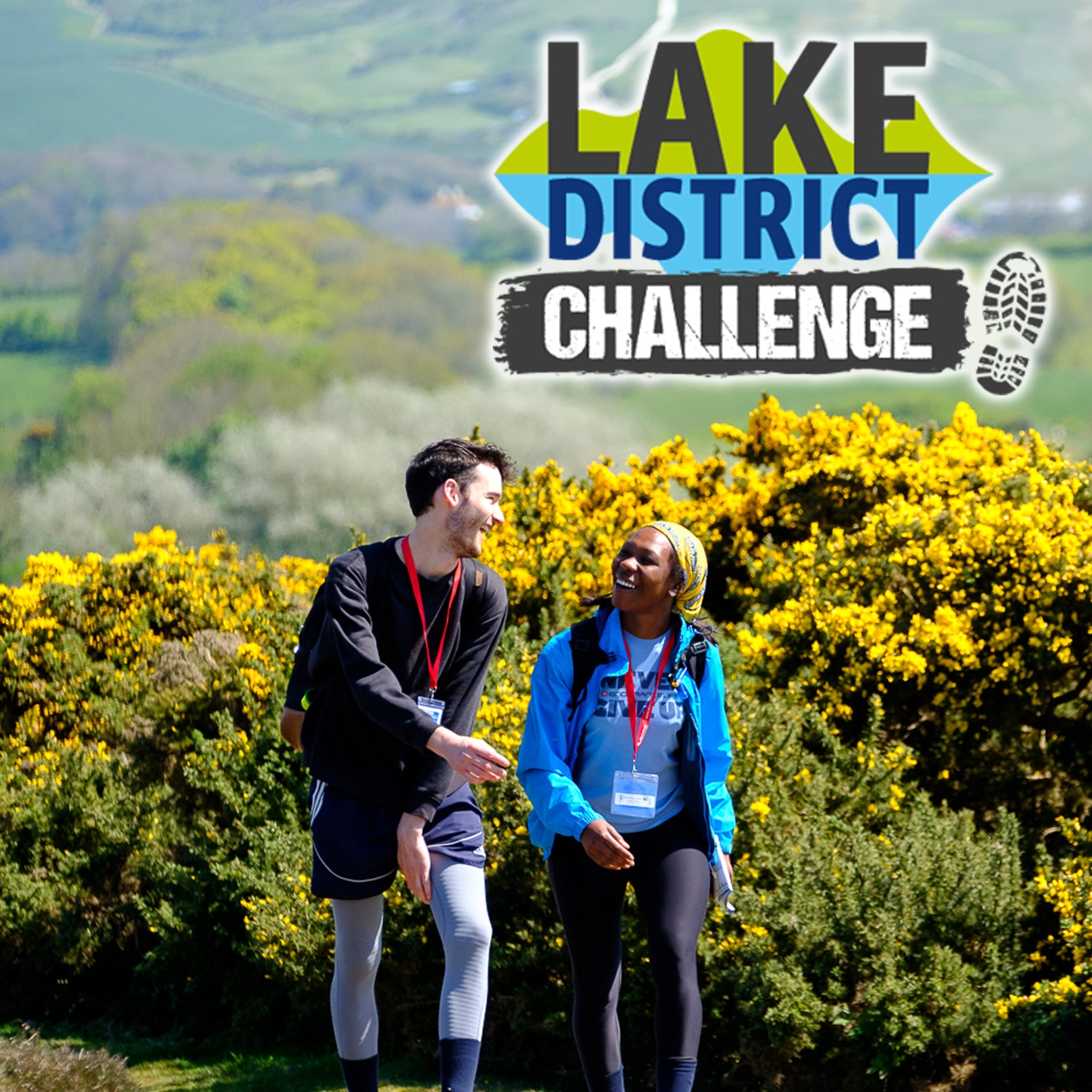Image shows two walkers with yellow gorse in the background. 'Lake District Challenge' is written on the top right of the image.