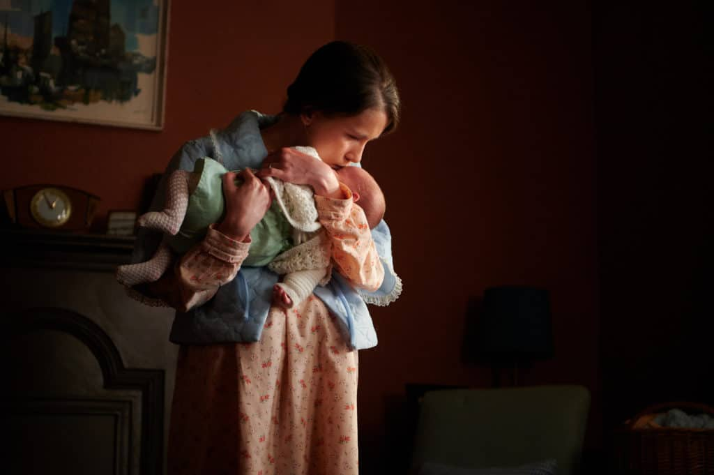 Marion holding her baby