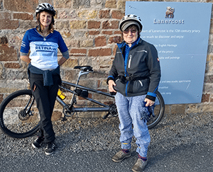 Maddie and Isobel with a tandem bicycle