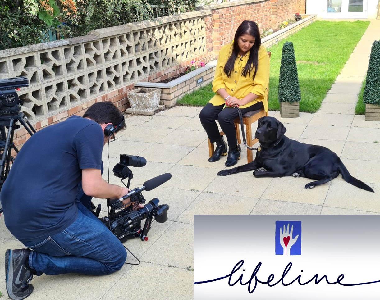 Retina UK Ambassador Bhavini Makwana being filmed for the BBC Lifeline appeal along with Colin the guide dog