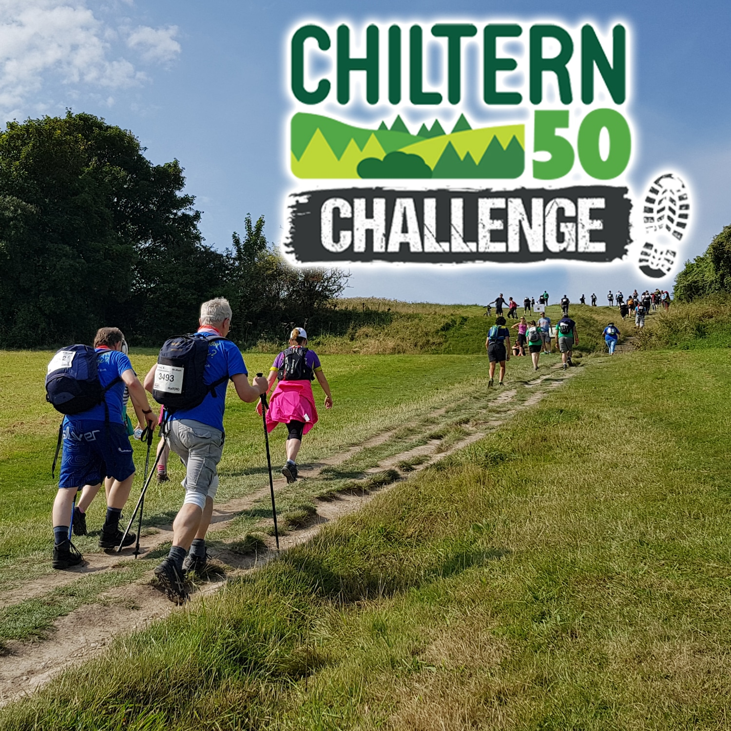 Images shows a group of three walkers walking along a trail with other walkers in the distance. Green fields and trees line the trail. Images shows a group of three walkers walking along a trail with other walkers in the distance. Green fields and trees line the trail. 'Chiltern 50 Challenge' is written on the top right of the image.