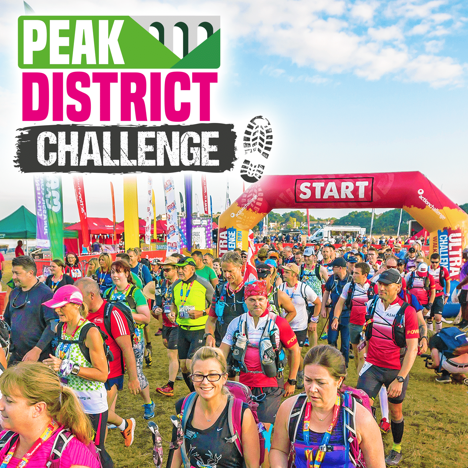 Image shows crowd of participants at the start line with the Peak District Challenge logo